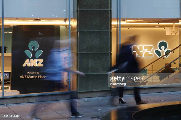 Pedestrians walk past an Australia New Zealand Banking Group Ltd branch in Sydney Australia on Friday June 1 2018 Australia's banking industry faces...