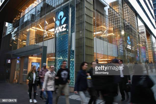 Pedestrians walk past an Australia New Zealand Banking Group Ltd branch in Sydney Australia on Friday June 1 2018 Australia's banking industry faces...