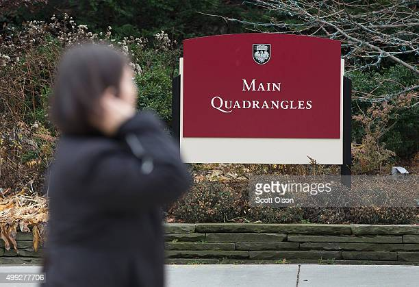 Pedestrians walk past an entrance to the Main Quadrangles on the Hyde Park Campus of the University of Chicago on November 30, 2015 in Chicago,...