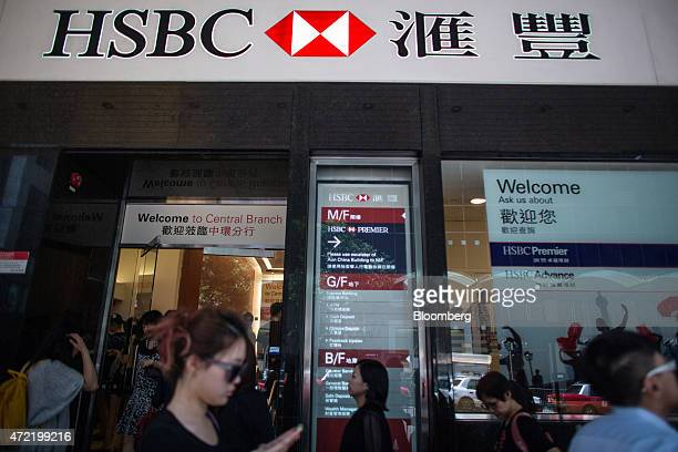 Pedestrians walk past an HSBC Holdings Plc bank branch in the Central district of Hong Kong China on Monday May 4 2015 HSBC is scheduled to release...