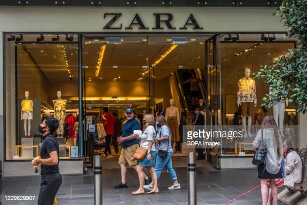 Pedestrians walk past apparel retail store and logo, Zara seen on Bourke Street in Melbourne.