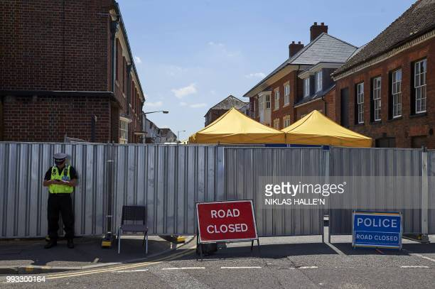 TOPSHOT Pedestrians walk past barriers across Rollestone Street outside the John Baker House Sanctuary Supported Living in Salisbury southern England...