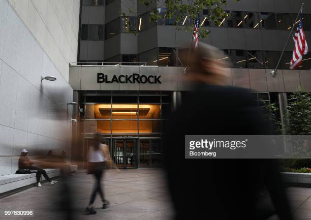 Pedestrians walk past BlackRock Inc headquarters in New York US on Wednesday June 11 2018 BlackRock Inc is scheduled to release earnings figures on...
