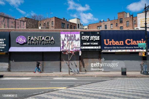 Pedestrians walk past closed stores on Fordham Road in the Bronx borough of New York, U.S., on Thursday, April 2, 2020. In four months, the new...