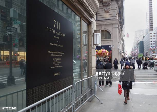 Pedestrians walk past empty retail space on 5th Avenue on February 8 2018 in New York The New York borough of Manhattan is richer and more populated...