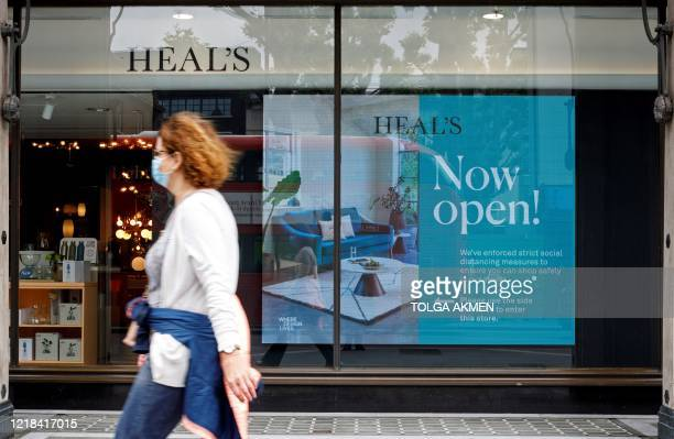 Pedestrians walk past Heal's flagship store in central London on June 8 following the easing of the lockdown restrictions during the novel...