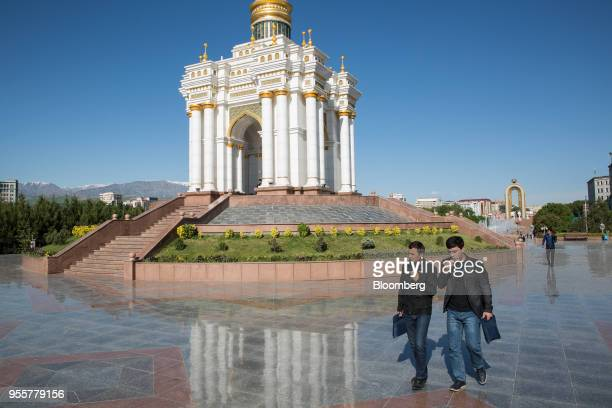 Pedestrians walk past Independence Monument in Dushanbe Tajikistan on Saturday April 21 2018 Flung into independence after the Soviet Union collapsed...