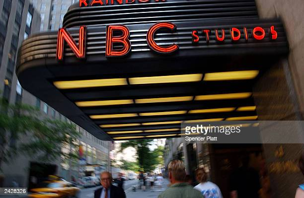 Pedestrians walk past NBC studios June 24, 2003 in New York City. NBC is the top contender to acquire French conglomerate Vivendi's Universal Studios...
