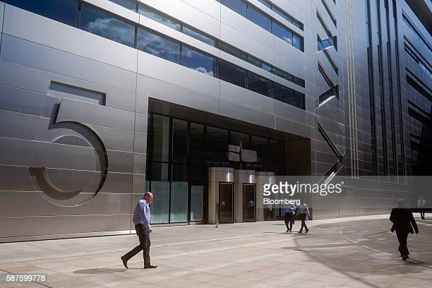 Pedestrians walk past No 5 Broadgate an office complex to be occupied by UBS AG as construction work nears completion in London UK on Tuesday Aug 9...