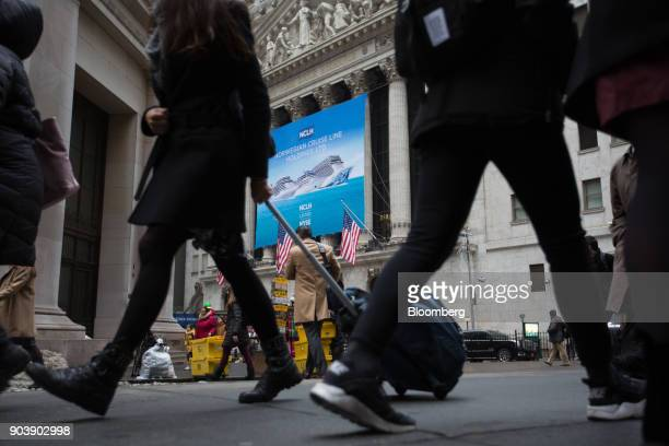 Pedestrians walk past Norwegian Cruise Line Holdings Ltd signage displayed in front of the New York Stock Exchange in New York US on Thursday Jan 11...