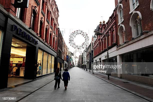 Pedestrians walk past Pennys department store, left, in Henry Street, Dublin, Ireland, on Sunday, Nov. 13, 2011. German Chancellor Angela Merkel said...