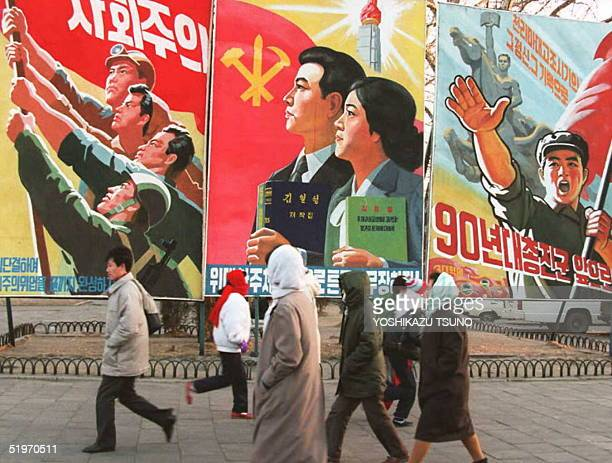Pedestrians walk past propaganda posters 27 January in central Pyongyang. The Central People's Committee announced 07 February that 16 February will...