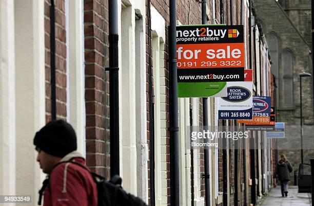 Pedestrians walk past residential properties advertised For Sale and To Let in Newcastle Upon Tyne UK on Thursday Nov 27 2008 UK home sales declined...