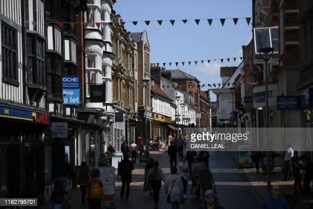 Pedestrians walk past shops in Ipswich east England on August 19 where British musician Ed Sheeran used to play gigs Ipswich in eastern England has...