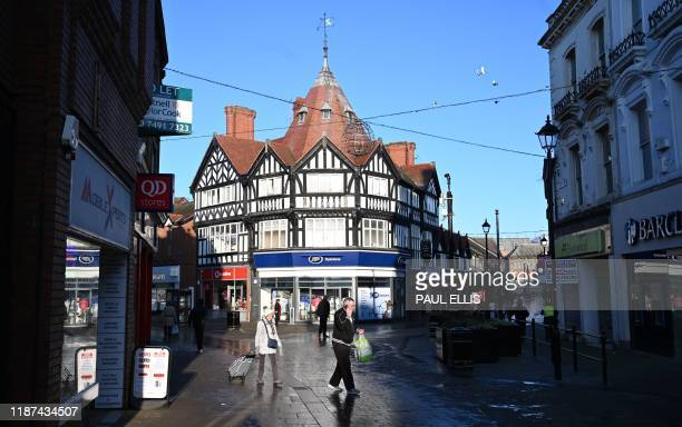 Pedestrians walk past shops in the town centre in Wrexham on December 4 2019 A Labourheld seat since 1935 Wrexham is forecast to elect a Conservative...