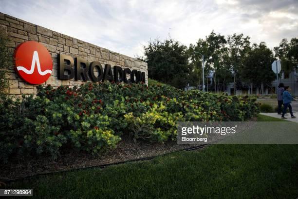 Pedestrians walk past signage displayed outside of Broadcom Ltd headquarters in Irvine California US on Monday Nov 6 2017 Broadcom Ltdand its...