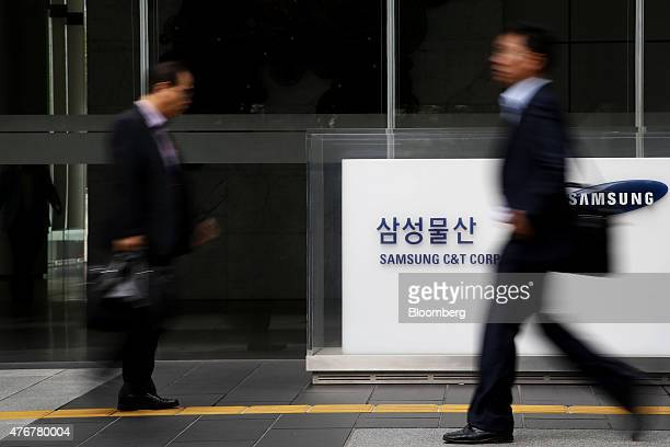 Pedestrians walk past signage for Samsung CT Corp at the company's headquarters in Seoul South Korea on Friday June 12 2015 American hedgefund...