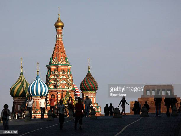 Pedestrians walk past St Basil's Cathedral in Red Square in Moscow Russia on Monday June 22 2009 The ruble fell against the dollar and the central...
