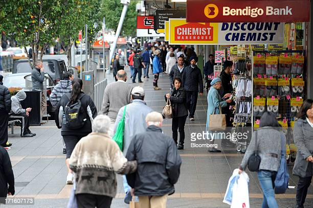 Pedestrians walk past stores along Church Street mall in the suburb of Parramatta in western Sydney Australia on Monday June 24 2013 Chris Bowen a...