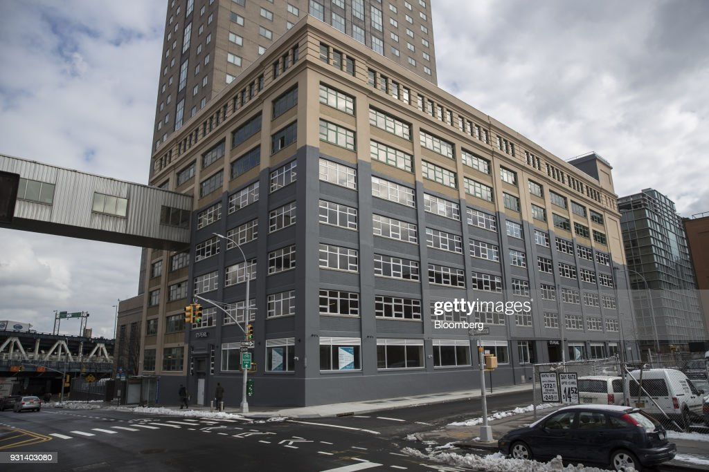 Pedestrians walk past the 175 Pearl building in the Dumbo neighborhood of the Brooklyn borough of New York, U.S., on Thursday, March 8, 2018. Two months afterJaredKushnerjoined the White House as a senior adviser, his family firm sold a stake in a Brooklyn building to a unit of a company whose largest shareholder is the government of Japan. The buyer of record in the $103-million deal for 175 Pearl St. was Normandy Real Estate Partners, a New Jersey-based investment firm. But documents filed in Tokyo show that it was operating on behalf of a subsidiary ofNippon Telegraph & Telephone Corp. Photographer: Victor J. Blue/Bloomberg via Getty Images