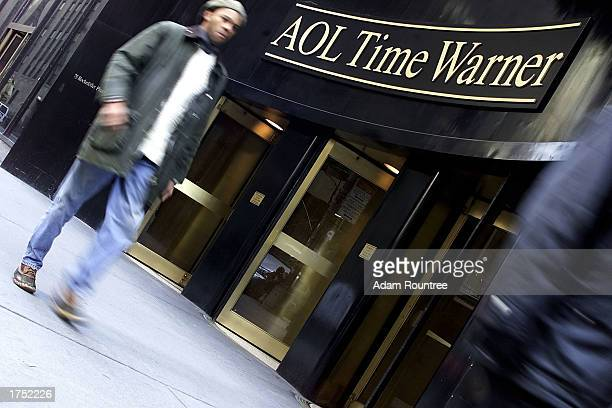 Pedestrians walk past the AOLTime Warner building January 16 2003 in New York City Vice Chairman Ted Turner announced his resignation January 29 2003...