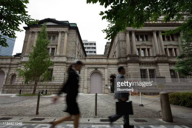 Pedestrians walk past the Bank of Japan headquarters in Tokyo, Japan, on Monday, July 8, 2019. Governor Haruhiko Kurodasaid extremely low interest...