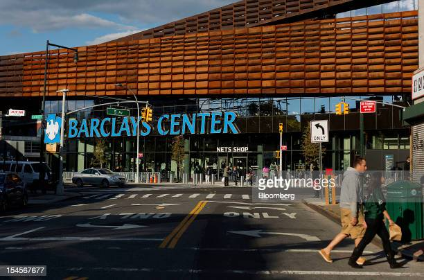 Pedestrians walk past the Barclays Center in the Brooklyn borough of New York, U.S., on Sunday, Oct. 21, 2012. The Barclays Center, the...