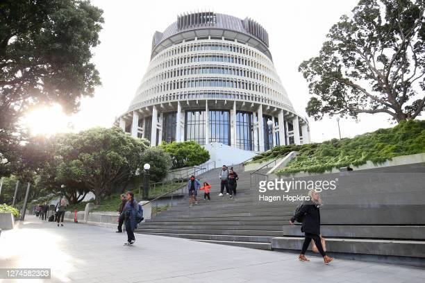 Pedestrians walk past The Beehive after a move to COVID-19 Alert Level 1 on September 22, 2020 in Wellington, New Zealand. Coronavirus restrictions...