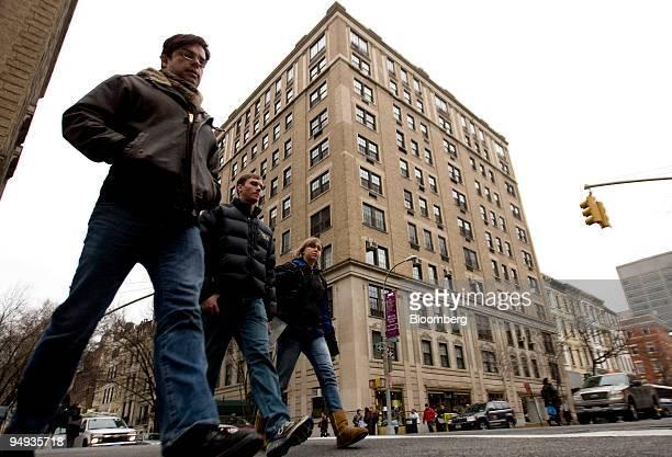 Pedestrians walk past the building that houses the apartment of Bernard Madoff president and founder of Bernard L Mandoff Investment Securities LLC...
