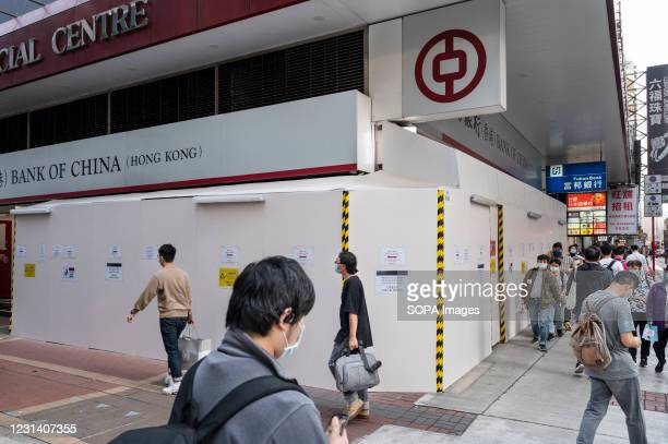 Pedestrians walk past the Chinese state-owned commercial banking company, Bank of China branch in Hong Kong.