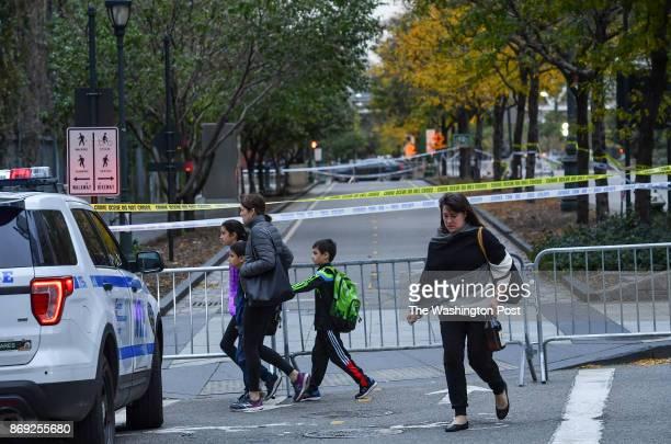 Pedestrians walk past the closed bike path where Sayfullo Saipov an Uzbek immigrant drove a rental truck down for twenty blocks killing eight people...