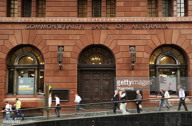 Pedestrians walk past the Commonwealth Bank of Australia branch at Martin Place in Sydney Australia on Monday Feb 10 2014 Commonwealth Bank...