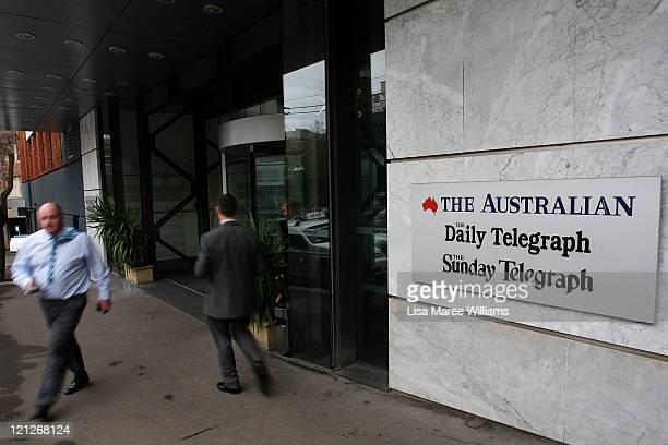 Pedestrians walk past the editorial headquarters of News Ltd, the Australian unit of News Corp on August 17, 2011 in Sydney, Australia. Australia's...