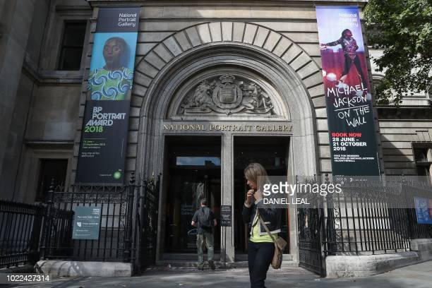 Pedestrians walk past the entrance to the National Portrait Gallery in central London on August 24 2018