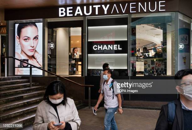 Pedestrians walk past the French multinational clothing and beauty products brand Chanel store seen in Hong Kong.