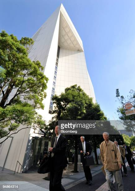 Pedestrians walk past the headquarters of Aozora Bank Ltd in Tokyo Japan on Tuesday Oct 28 2008 Aozora Bank Ltd the worst performer in the Topix...