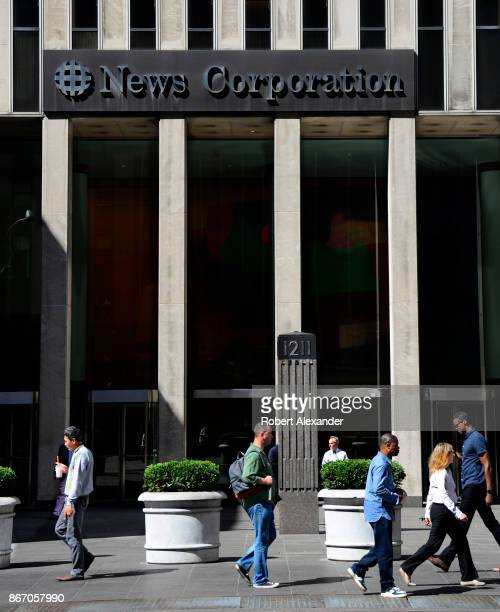 Pedestrians walk past the headquarters of the News Corp building in Midtown Manhattan, New YOrk City.