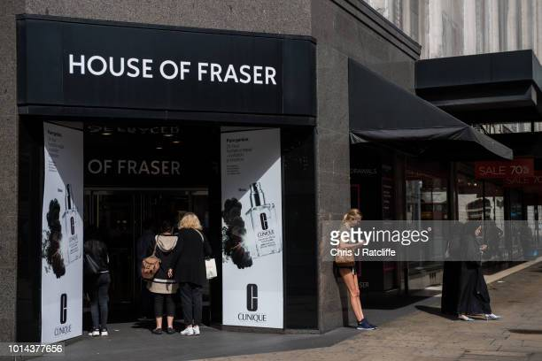 Pedestrians walk past the House of Fraser flagship store on Oxford Street on August 10 2018 in London England The high street retailers House of...