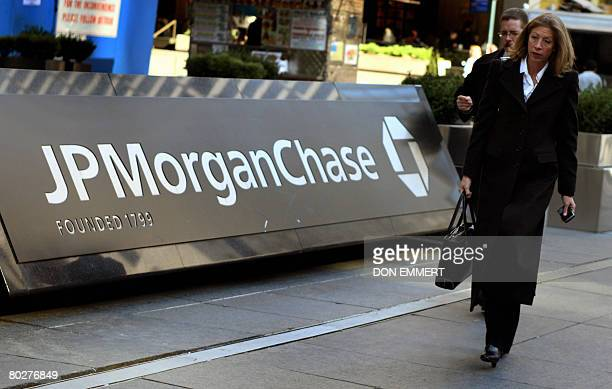 Pedestrians walk past the JP Morgan Chase headquarters in New York on March 17 2008 JP Morgan Chase bought Bear Stearns Co for 2 USD a share with...
