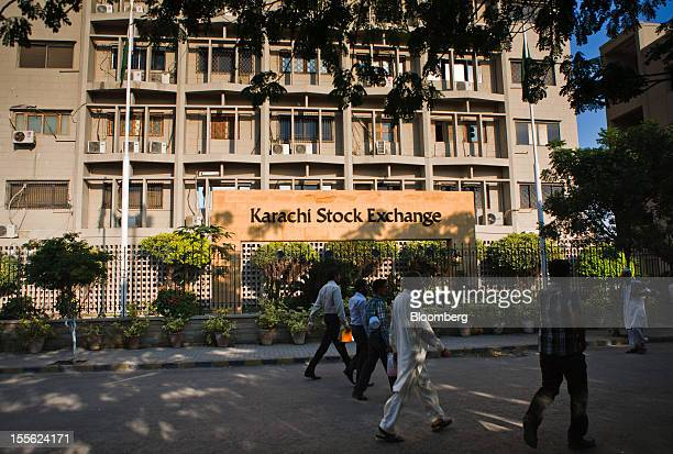 Pedestrians walk past the Karachi Stock Exchange in Karachi Pakistan on Tuesday Oct 30 2012 Businesses in Pakistan's commercial capital are bracing...