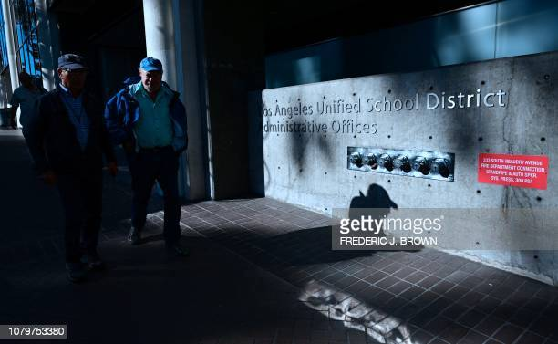 Pedestrians walk past the Los Angeles Unified School District headquarters in Los Angeles, California on January 9, 2019. - Teachers in the nation's...