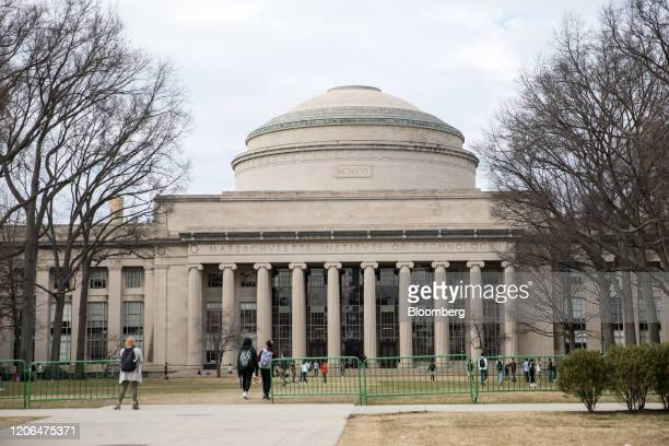 Pedestrians walk past the Maclaurin Building at the Massachusetts Institute of Technology campus in Cambridge Massachusetts US on Tuesday March 10...