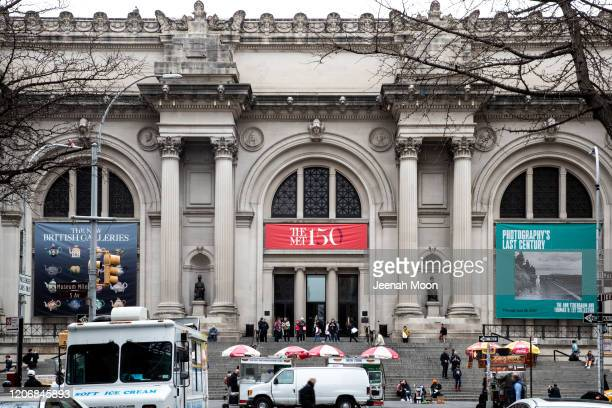 Pedestrians walk past the Metropolitan Museum of Art on March 10, 2020 in New York City on March 12, 2020 in New York City. The museum announced it...