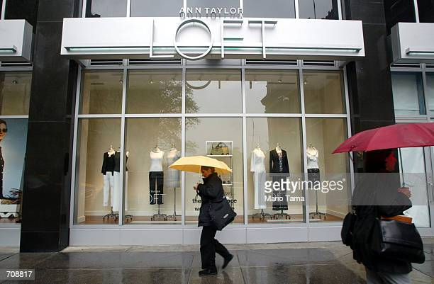 Pedestrians walk past the new Ann Taylor Loft store located near Ground Zero April 22 2002 in New York City Ann Taylor is the first brand name retail...