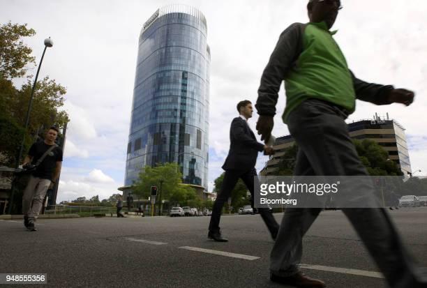 Pedestrians walk past the new headquarters of Woodside Petroleum Ltd in Perth Australia on Thursday April 19 2018 One partner in the NorthWest Shelf...