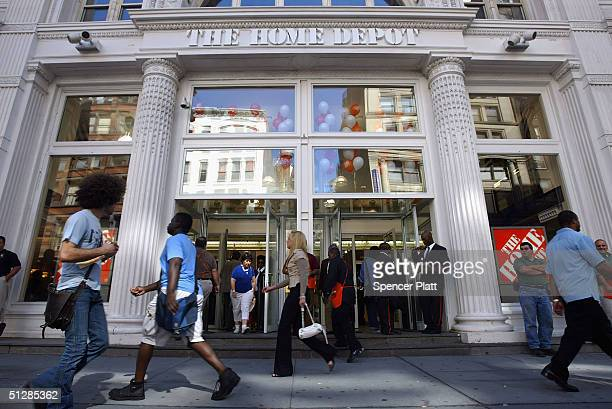 Pedestrians walk past the new threelevel Home Depot megastore on West 23rd street September 10 2004 in New York City The new store which occupies the...