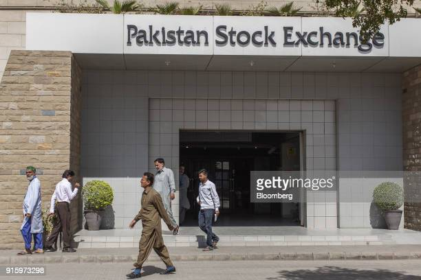 Pedestrians walk past the Pakistan Stock Exchange building in Karachi Pakistan on Thursday Feb 8 2018 The selloff inglobal stocksthat briefly...