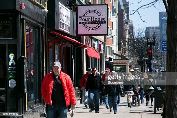 Pedestrians walk past the Pour House Bar and Grill on Boylston Street in Boston Massachusetts US on Friday April 4 2014 The second bomb of the 2013...