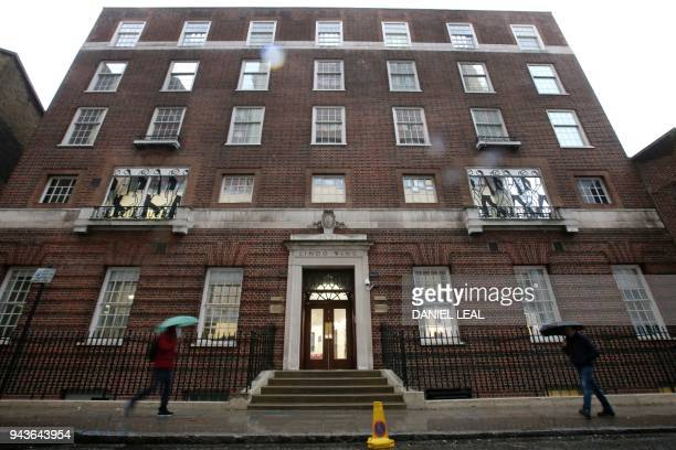 TOPSHOT Pedestrians walk past the private Lindo Wing of St Mary's Hospital in central London on April 9 where Britain's Catherine Duchess of...