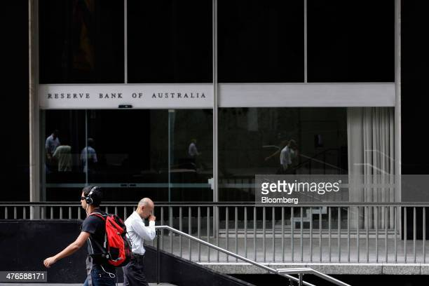 Pedestrians walk past the Reserve Bank of Australia headquarters in the central business district of Sydney Australia on Tuesday March 4 2014...